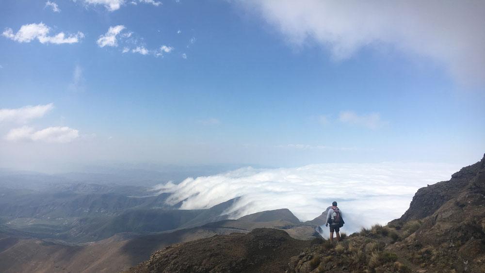 single traveller hikes on a mountain in drakensberg